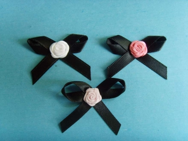 Black satin ribbon bows with colourful rose bows